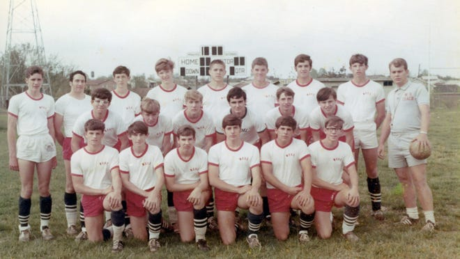 Team photo of the 68-69 inaugural Wade Hampton soccer team coached by Brodie Bricker, right.