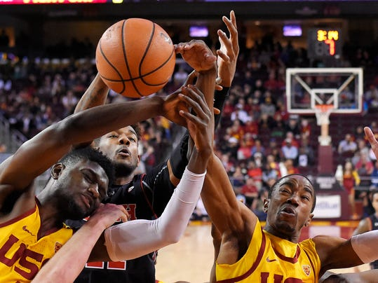 Southern California forward Chimezie Metu, and guard Shaqquan Aaron, right, reach for a rebound along with Utah forward Chris Seeley during the second half of an NCAA college basketball game, Sunday, Jan. 14, 2018, in Los Angeles. USC won 84-67. (AP Photo/Mark J. Terrill)