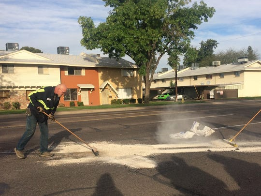Phoenix fire officials are seen cleaning a chemical