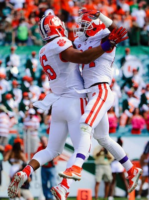 Clemson Tigers wide receiver Ray-Ray McCloud (right) celebrates after Clemson end Jordan Leggett (left) scored a touchdown in the first half.