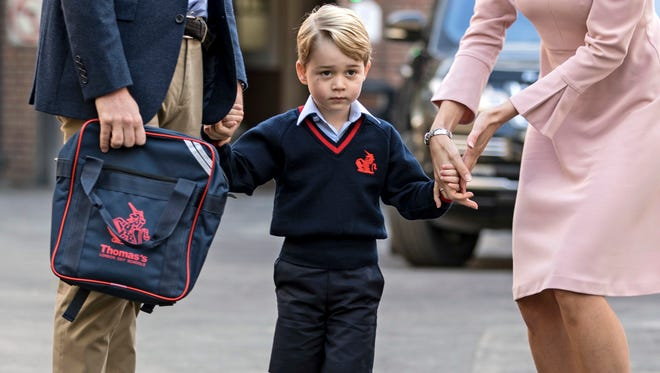 Prince George of Cambridge on his first day of school on Sept. 7, 2017, accompanied by his father Prince William and school head Helen Haslem.