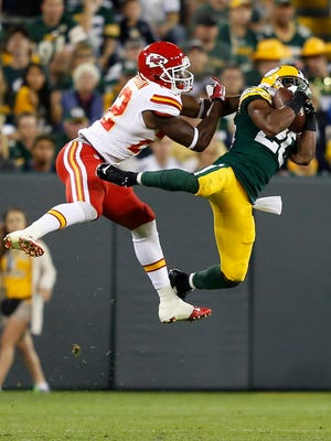 Green Bay Packers cornerback Jumal Rolle intercepts a pass thrown to Kansas City Chiefs wide receiver Mark Harrison during a preseason game on Aug. 28. The play was called back because of a defensive penalty.