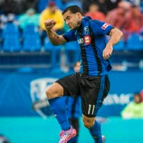 Montreal midfielder Dilly Duka goes up to head a ball in this AP file photo.