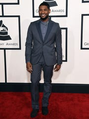 Usher arrives at the 57th annual Grammy Awards at the