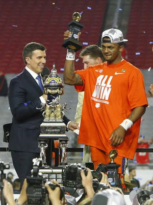 Offensive player the game, Clemson Tigers quarterback Deshaun Watson (4)  celebrates following their 31-0 win over the Ohio State Buckeyes during the College Football Playoff Semifinal game at the PlayStation Fiesta Bowl on Dec. 31, 2016 at University of Phoenix Stadium in Glendale, Arizona.