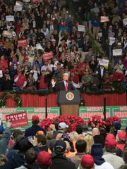 President Donald Trump addresses the crowd Friday, Dec. 8, 2017, during a rally at the Pensacola Bay Center.