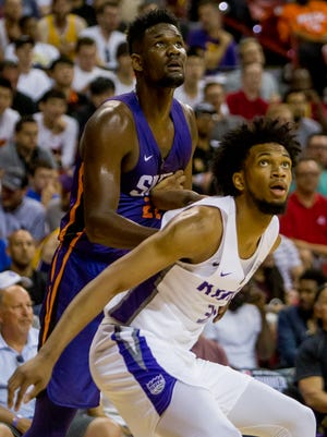 Phoenix Suns center Deandre Ayton (22) and Sacramento Kings forward Marvin Bagley III (35) look to the ball on July 7, 2018, during the Phoenix Suns' NBA Summer League matchup against the Sacramento Kings at the University of Nevada Las Vegas.