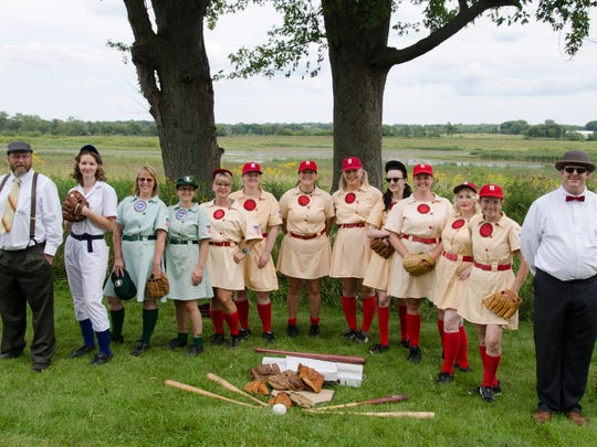 Members of the League of Our Own WWII Girls Baseball Living History League pose for a photo.