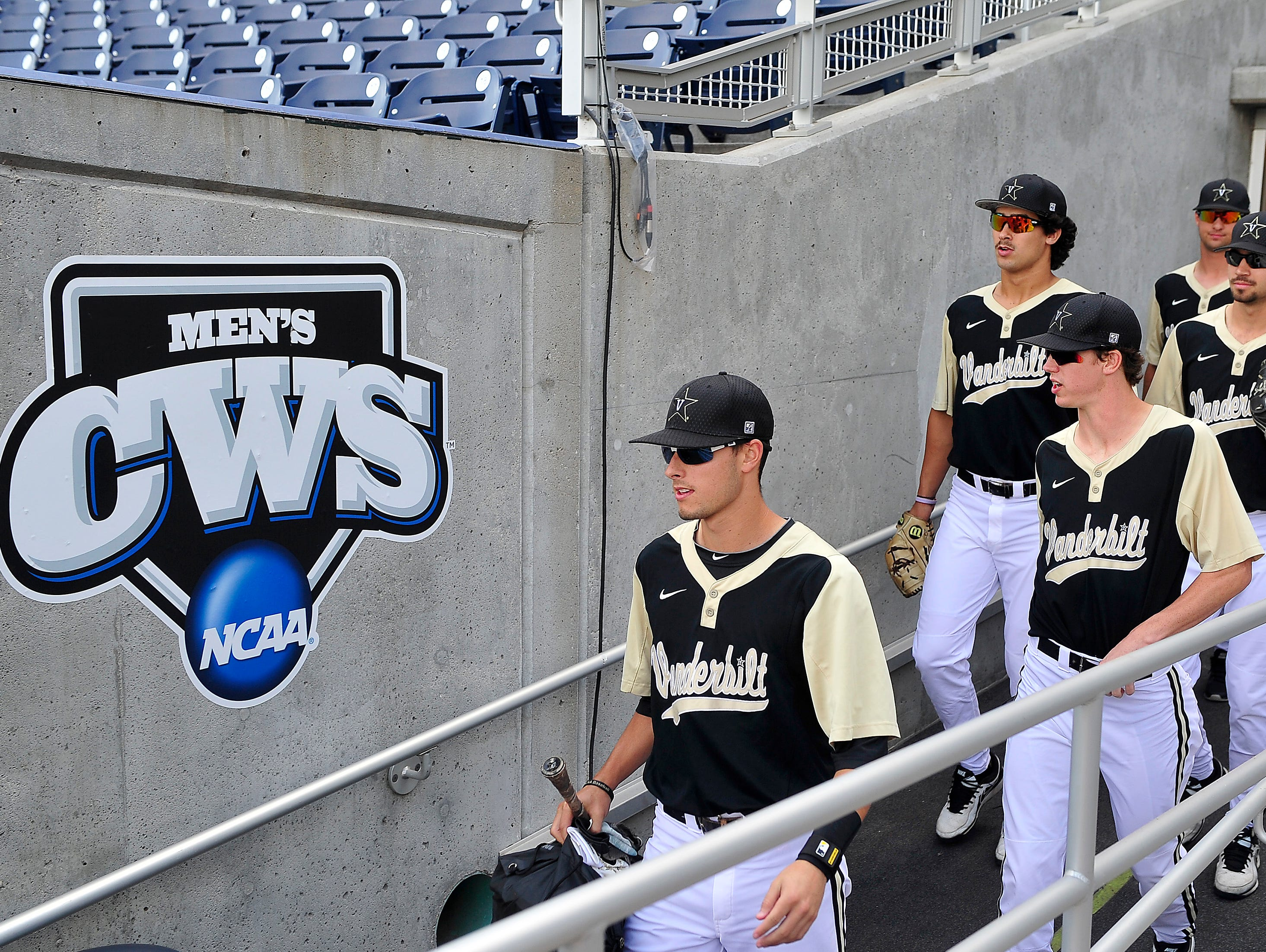 Vanderbilt players walk to the dugout to play Virginia at the College World Series at TD Ameritrade Park in Omaha, Neb., Wednesday, June 25, 2014.