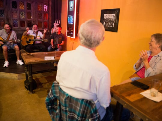 John Rosenbaum, left, and his wife Toni clap along during Irish Music Night at Riptide Brewing Company Wednesday, June 14, 2017 in Naples. The weekly tradition brings like minded musicians together to experiment with Irish songs.