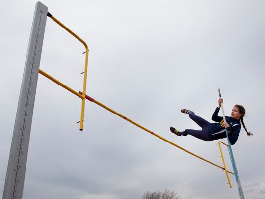 Port Huron Northern freshman Avery Shell, 14, competes in the pole vault during a track meet Thursday, April 17, 2015 at Port Huron High School.