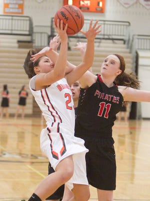 Brighton's Maria Raneses is fouled by Pinckney's Lexi Curtis during the Bulldogs' 47-31 victory.