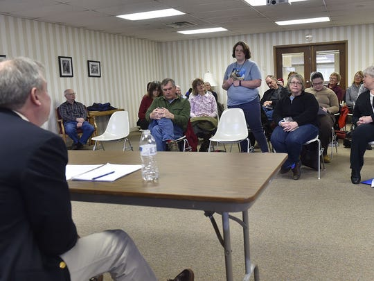 Melissa Wolfe addresses the housing issues in Door County during a listening session hosted by Wisconsin's 1st Assembly District Rep. Joel Kitchens of Sturgeon Bay at the Door County Library in Sturgeon Bay on Monday.