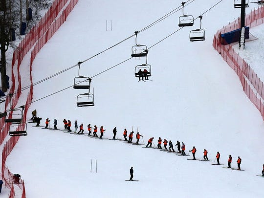 Side-slippers regroup after working their way down the course, smoothing out the Superstar trail before the 2016 Audi FIS Ski Alpine Ski World Cup at Killington Resort in central Vermont.