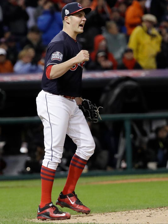 Cleveland Indians starting pitcher Trevor Bauer reacts to a double play during the fourth inning of Game 2 of the Major League Baseball World Series against the Chicago Cubs Wednesday, Oct. 26, 2016, in Cleveland. (AP Photo/David J. Phillip)