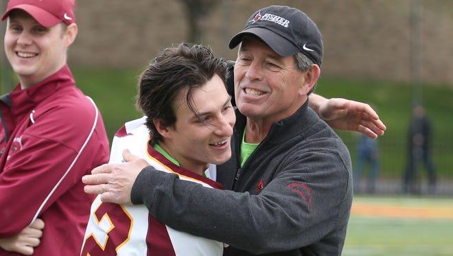 St. John Fisher College man's lacrosse head coach John Johnson hugs senior Daniel Page before their game against Alfred Saturday, April 29, 2017 at Growney Stadium.