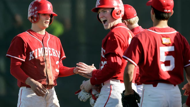 Kimberly's Griffin Hawley (left) is congratulated by teammates after scoring a run against Appleton North during Tuesday's game in Appleton.