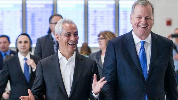 Chicago Mayor Rahm Emanuel (left) and American Airlines
