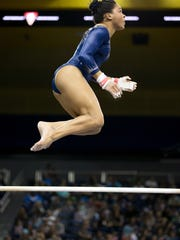 JaNay Honest, an El Diamante graduate, competes for the UCLA women's gymnastics team in the bars this past season.