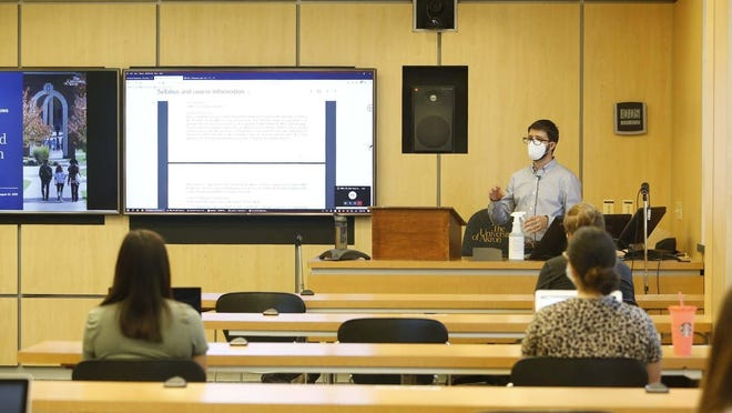 Adel Alhalawani leads a biomedical engineering class with 19 in-person students and 21 online at the University of Akron on Aug. 24, 2020, in Akron, Ohio.