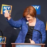 Democratic primary candidate for mayor of New York City Christine Quinn reacts during the first debate at Town Hall.