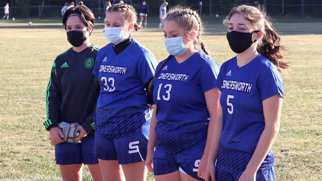 Somersworth High School girls soccer captains, from left, Molly Lewis, Haley Donnell, Lexi Tardif and Becca Pincince, led their team to a 4-0 win over Prospect Mountain last Thursday.