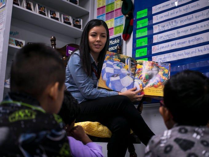 Claudia Quezada reads to her kindergarten class at