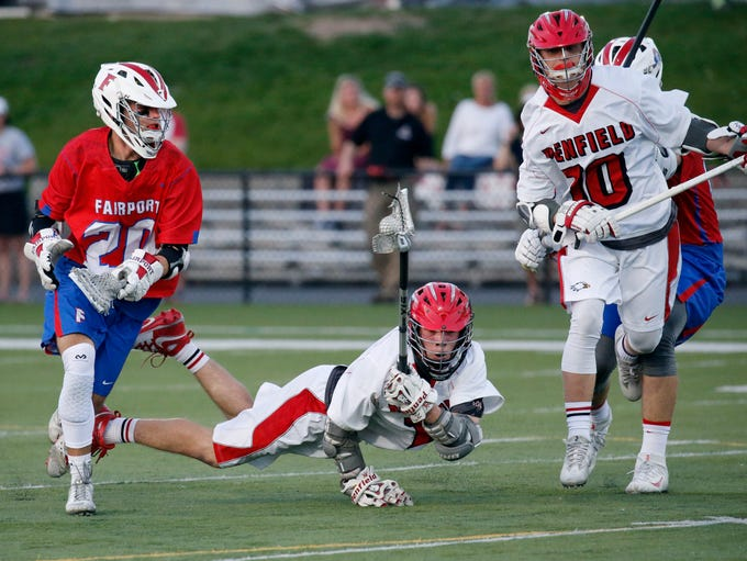 Penfield's Austin Hudson picks up the ball next to