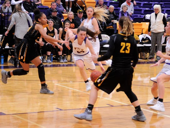 Wylie's Mary Lovelace drives into the lane during the