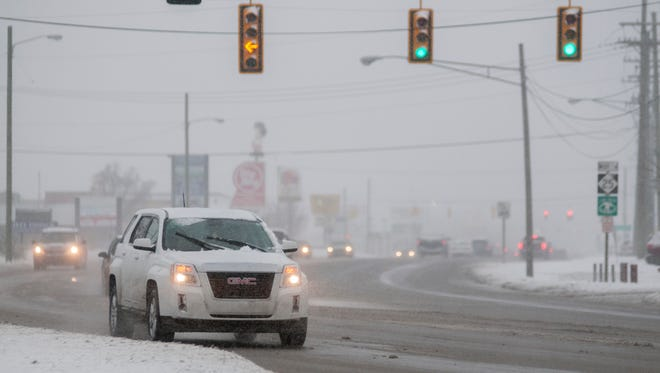 Take caution while driving during a winter storm warning.