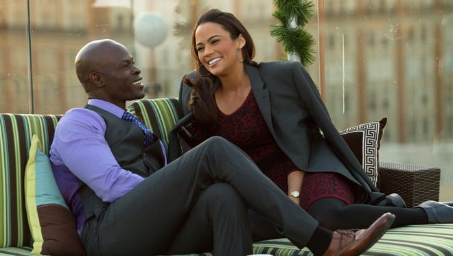 Djimon Hounsou  and Paula Patton star in the romantic comedy 'Baggage Claim.'