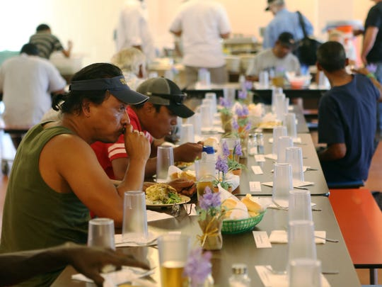 At 11:14 a.m., Carlos Romero, 45, spends his lunchtime with a free meal provided by Well in the Desert at First Baptist Church on Tuesday, May 3, 2016 in Palm Springs, Calif.