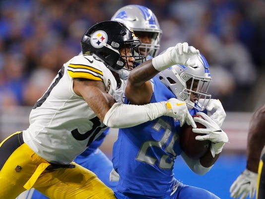 Pittsburgh Steelers inside linebacker Ryan Shazier (50) tackles Detroit Lions running back Theo Riddick (25) during the second half of an NFL football game, Sunday, Oct. 29 2017, in Detroit. (AP Photo/Paul Sancya)