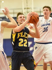 Elco Raider Jeffrey Lorahpushes past Falcon defenders