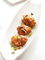 The king crab and sweet corn fritters were pleasantly delicate in texture.