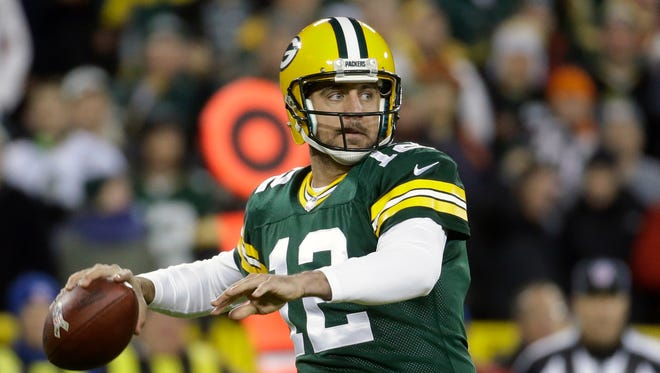 Green Bay Packers quarterback Aaron Rodgers (12) throws a pass during the first half of an NFL football game against the Chicago Bears Sunday, Nov. 9, 2014, in Green Bay, Wis.