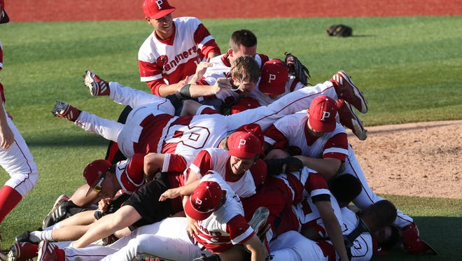 PRP pitcher Garrett Schmeltz (21) was mobbed by teammates after striking out the last Desales batter to win the 6th Region Championship at Patterson Stadium.  May 31, 2017