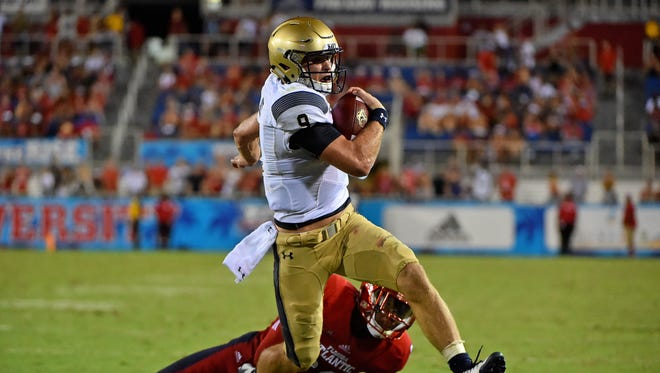 Sep 1, 2017; Boca Raton, FL, USA; Navy Midshipmen quarterback Zach Abey (9) runs the ball in for a touchdown against the Florida Atlantic Owls during the second half at FAU Football Stadium. Mandatory Credit: Jasen Vinlove-USA TODAY Sports