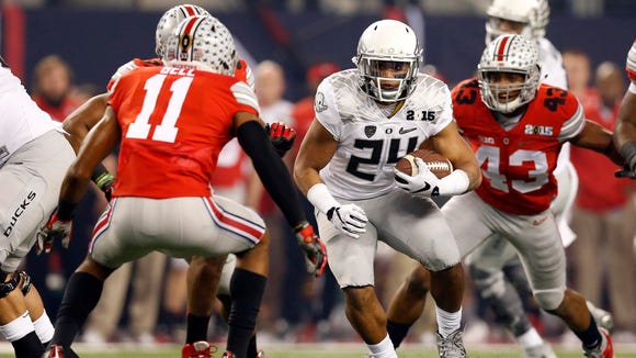 Jan 12, 2015; Arlington, TX, USA; Oregon Ducks running back Thomas Tyner (24) runs against the Ohio State Buckeyes in the first quarter in the 2015 CFP National Championship Game at AT&T Stadium. Mandatory Credit: Matthew Emmons-USA TODAY Sports