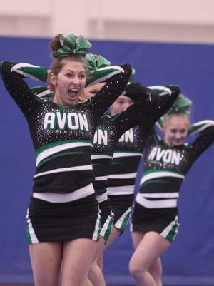 Avon cheerleaders perform part of their dance routine.
