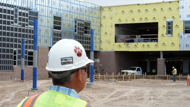 Herb Borden, construction management director for the Deming Public Schools, oversees the construction of the new Deming High School scheduled to open in August and time for the 2017-2018 school year. The Wildcat paw print on Borden's hardhat was issued to all construction workers who were hired locally for the project.