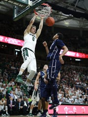 Kyle Ahrens dunks during the second half of MSU's win over Penn State Sunday.