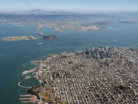 The Golden Gate Bridge and the San Francisco Bay are
