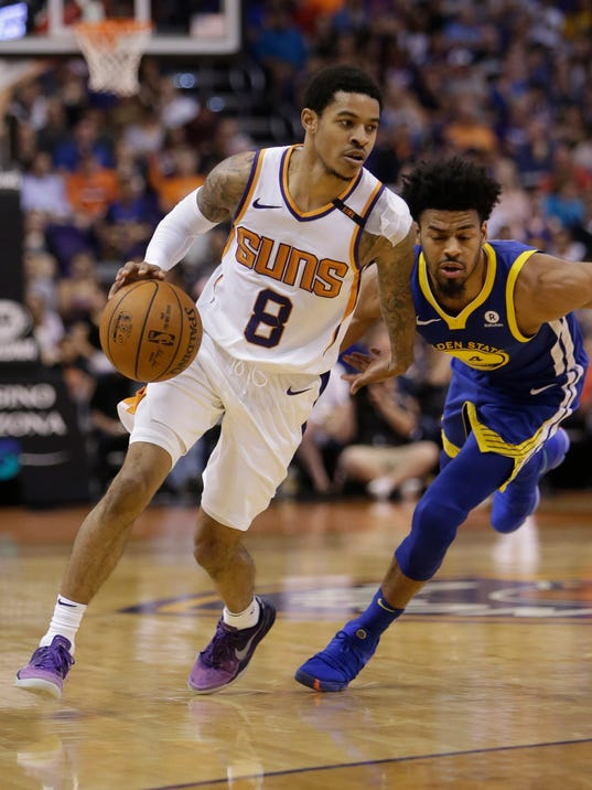 Phoenix Suns guard Tyler Ulis (8) drives past Golden State Warriors guard Quinn Cook in the second half during an NBA basketball game, Sunday, April 8, 2018, in Phoenix. The Warriors defeated the Suns 117-100. (AP Photo/Rick Scuteri)
