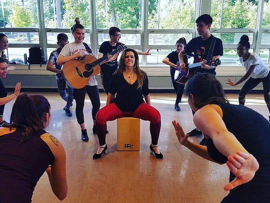 Renowned Brazilian tap dancer Christiane Matallo rehearses with Rowan University students in Glassboro for the production of 'House of the Murals.'