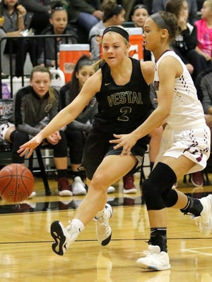 Amanda Fedor of Vestal is guarded by Elmira's Kiara Fisher in girls basketball Dec. 8 at Elmira High School.