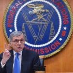 FCC Chairman Tom Wheeler announces the new rules on Thursday.