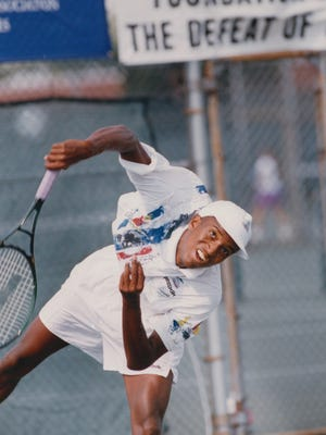 Michael Hopkinson, a former tennis pro, was No. 1 singes player for North Central's state champions in 1988 and 1989.