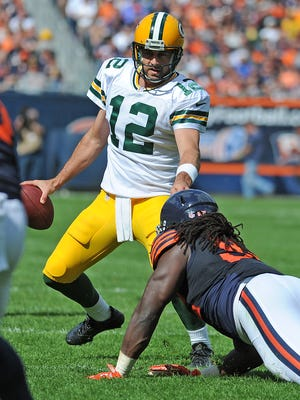Green Bay Packers quarterback Aaron Rodgers (12) scrambles in the fourth quarter against the Chicago Bears at Soldier Field.