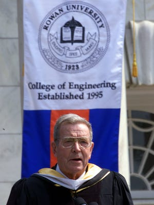 Under the banner of the school he helped create, Henry Rowan delivers the commencement address to the Rowan University Class of 2000.  -Under the banner of the school he helped create, Henry Rowan delivers Friday's graduation commencement address to the Rowan University class of 2000. This year marks the first time a class from the School of Engineering has graduated from the Glassboro based school. Photo by Avi Steinhardt/Courier-Post Staff.